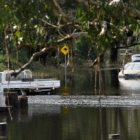 Cars sit in floodwaters in Londonderry, a suburb outside Sydney, on Thursday. | AFP-JIJI