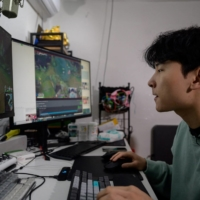 Kim Min-kyo, who often streams himself playing the online battle game League of Legends in his pyjamas, builds on his content with conversations that flirt with the country's social boundaries. | AFP-JIJI