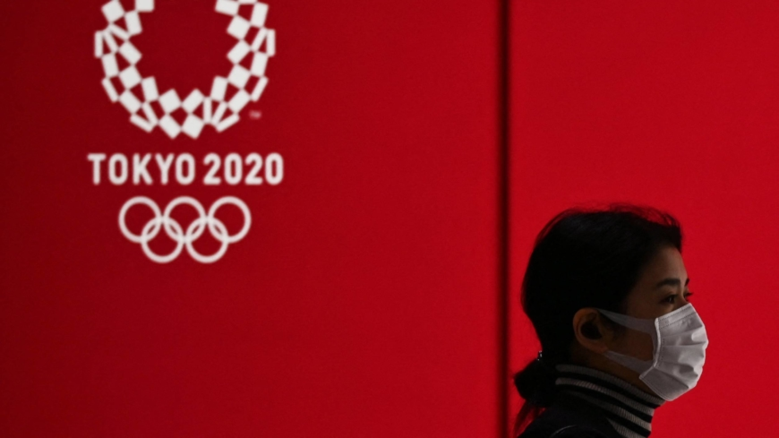 Japan considers halving number of official travelers to Olympics