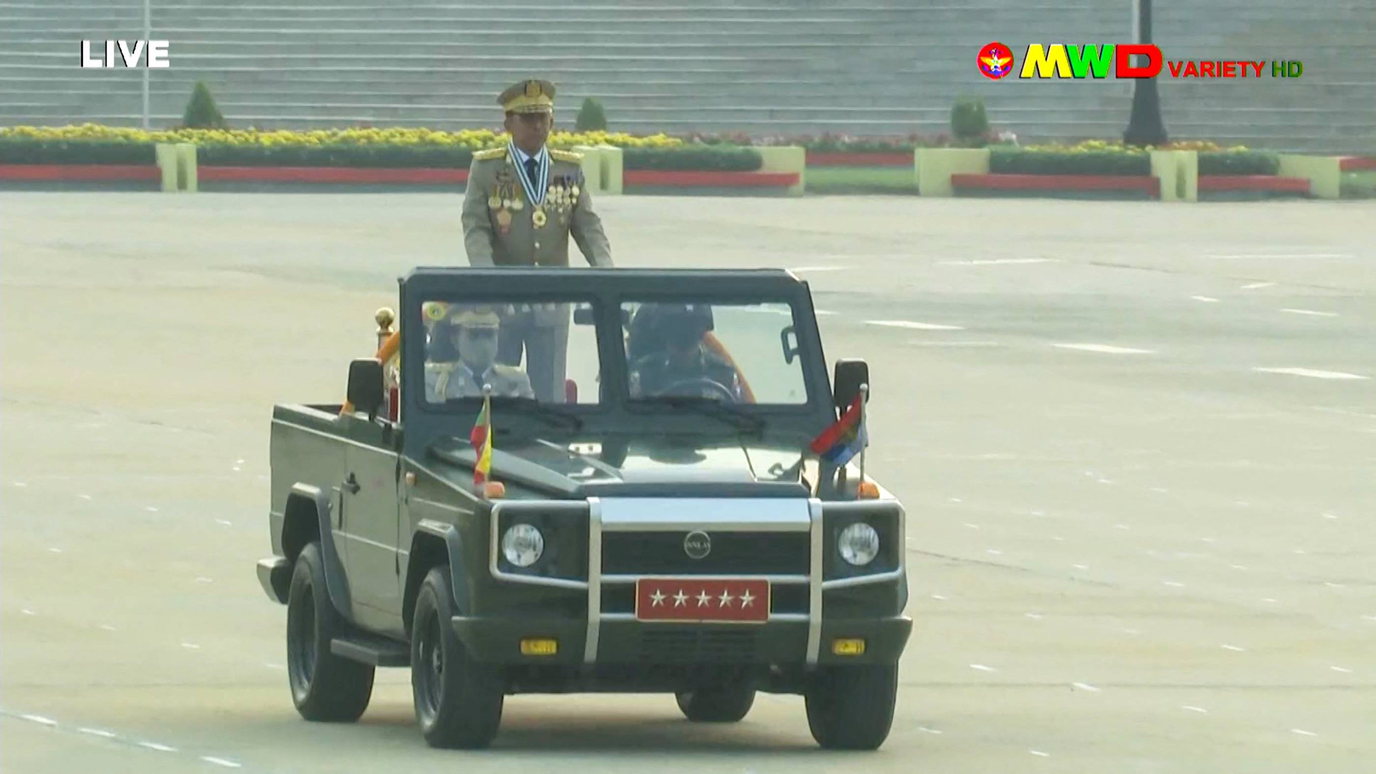 Myanmar armed forces chief Senior Gen. Min Aung Hlaing rides in car during an annual parade put on by the military to mark Armed Forced Day in the capital, Naypyidaw, in a screenshot taken from Myawaddy TV on Saturday. | MYAWADDY TV / VIA AFP-JIJI