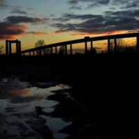 The sun sets on Kingsferry Bridge as seen from Sheerness, on the Isle of Sheppey, England.  | REUTERS