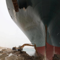 An excavator attempts to free the Ever Given on Thursday.  | SUEZ CANAL AUTHORITY / VIA REUTERS