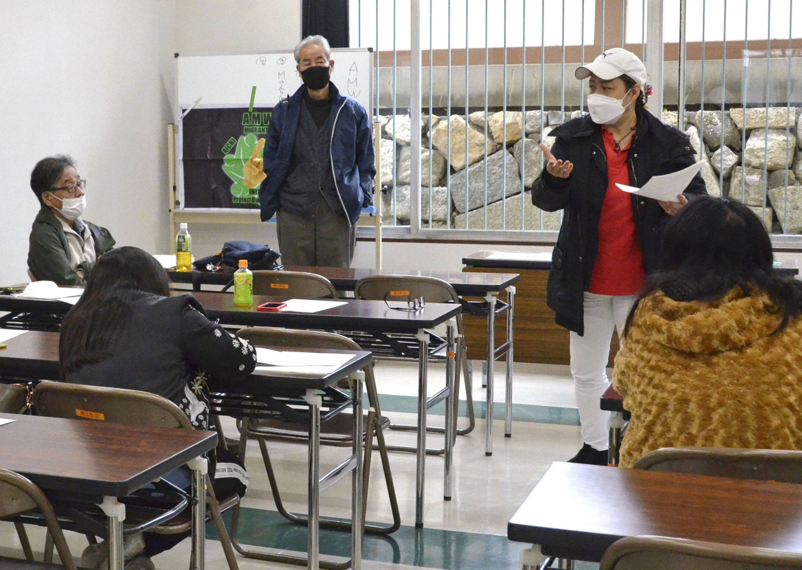 Members of Aichi Migrants Workers and Union Aichi gather to study labor laws in Nagoya on Feb. 14. | KYODO