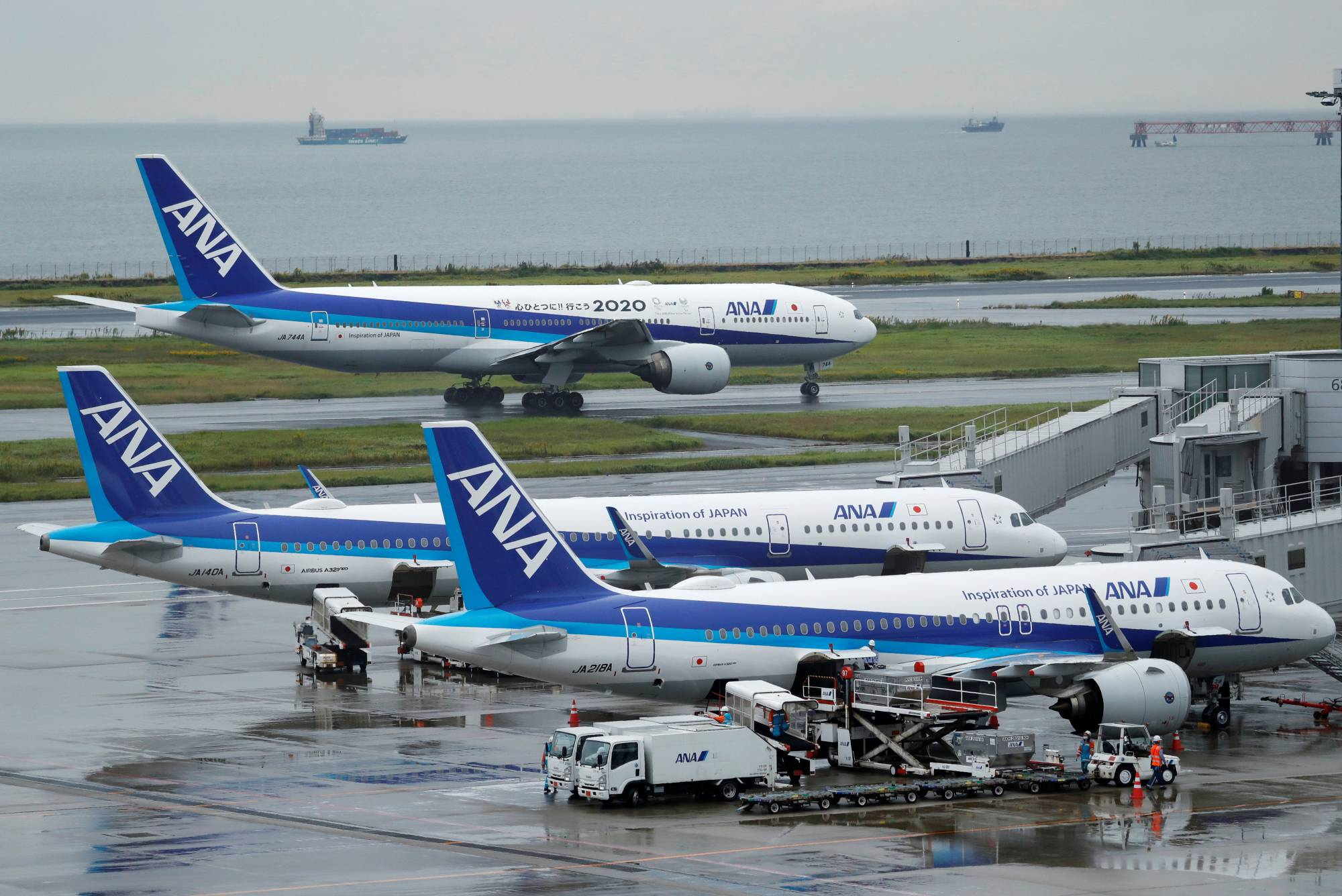 All Nippon Airways aircraft parked at Haneda Airport in Tokyo. With the virus crisis hitting the travel industry, airline group ANA Holdings Inc. will not recruit new graduates except for some job positions. | REUTERS