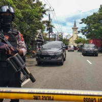 Suspected suicide bombing at Indonesian church wounds 14 people