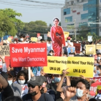 Demonstrators protest against the military coup in Yangon, Myanmar, on Feb. 15. | REUTERS