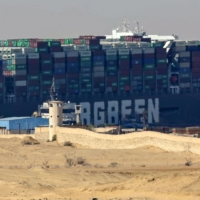 Diggers and dredgers struggle to free ship blocking Suez Canal