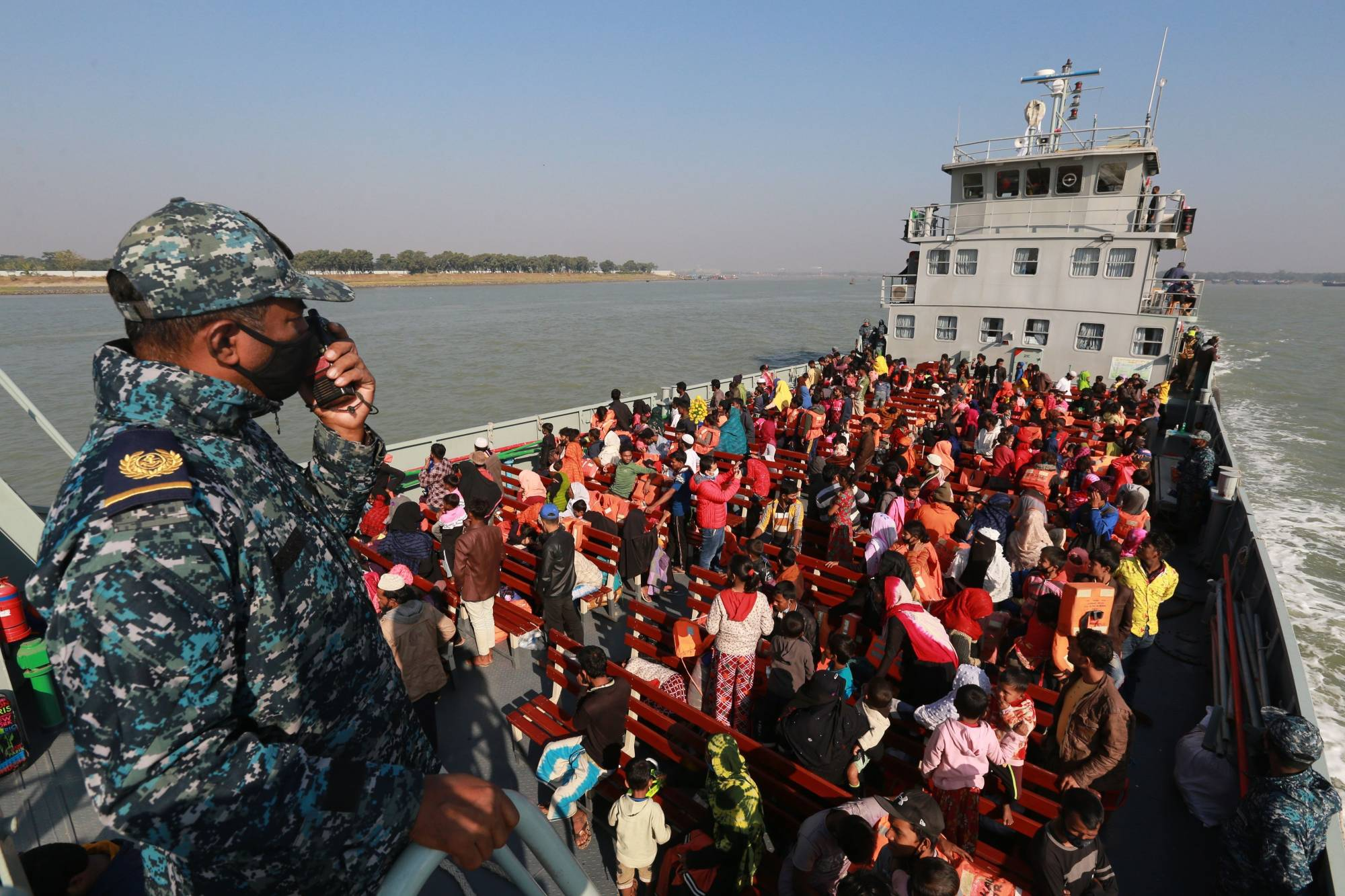 Rohingya refugees are relocated to the controversial flood-prone island Bhashan Char in the Bay of Bengal on Dec. 29. | GETTY IMAGES / VIA BLOOMBERG