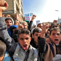 Supporters of Yemen's Houthi rebels attend a rally in Sanaa on Friday marking the sixth anniversary of the Saudi-led coalition's intervention in Yemen. | AFP-JIJI