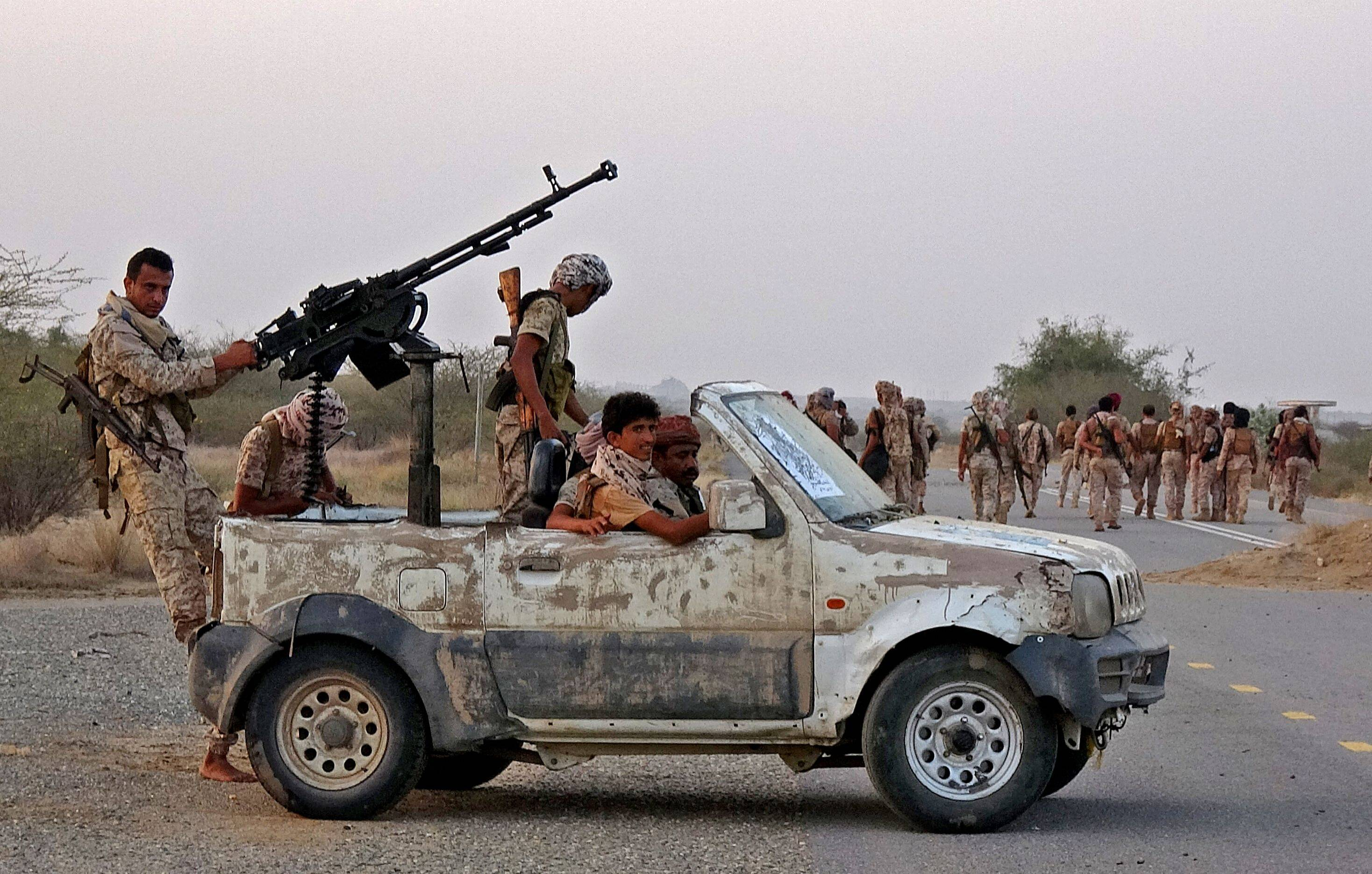Forces loyal to Yemen's Saudi-backed government enter the Abs district of the northwestern Hajjah province on March 11. | AFP-JIJI