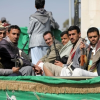 Armed Houthi followers depart after a funeral in Sanaa, Yemen, on Feb. 20 for fellow fighters killed in recent fighting against government forces in Yemen's oil-rich province of Marib. | REUTERS