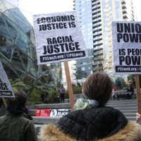 People rally at the Amazon Spheres and headquarters in Seattle in solidarity with Amazon workers in Bessemer, Alabama, who hope to unionize. | AFP-JIJI