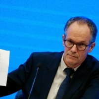 Peter Ben Embarek, a member of the World Health Organization team tasked with investigating the origins of the COVID-19 pandemic, speaks during a news conference at a hotel in Wuhan, China, in February.  | REUTERS