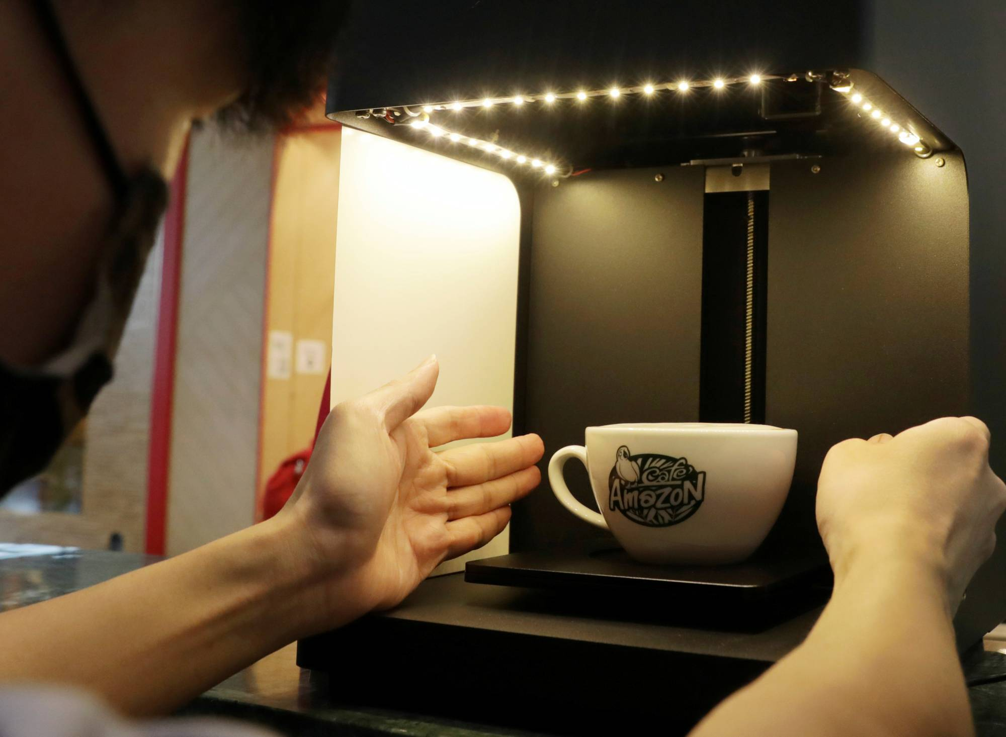 A staff member makes a cup of Cafe Amazon coffee in Singapore's Jewel Changi Airport | REUTERS