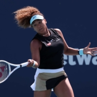 Naomi Osaka hits a forehand against Elise Mertens of Belgium in the fourth round of the Miami Open at Hard Rock Stadium in Miami on Monday. | USA TODAY SPORTS / VIA REUTERS