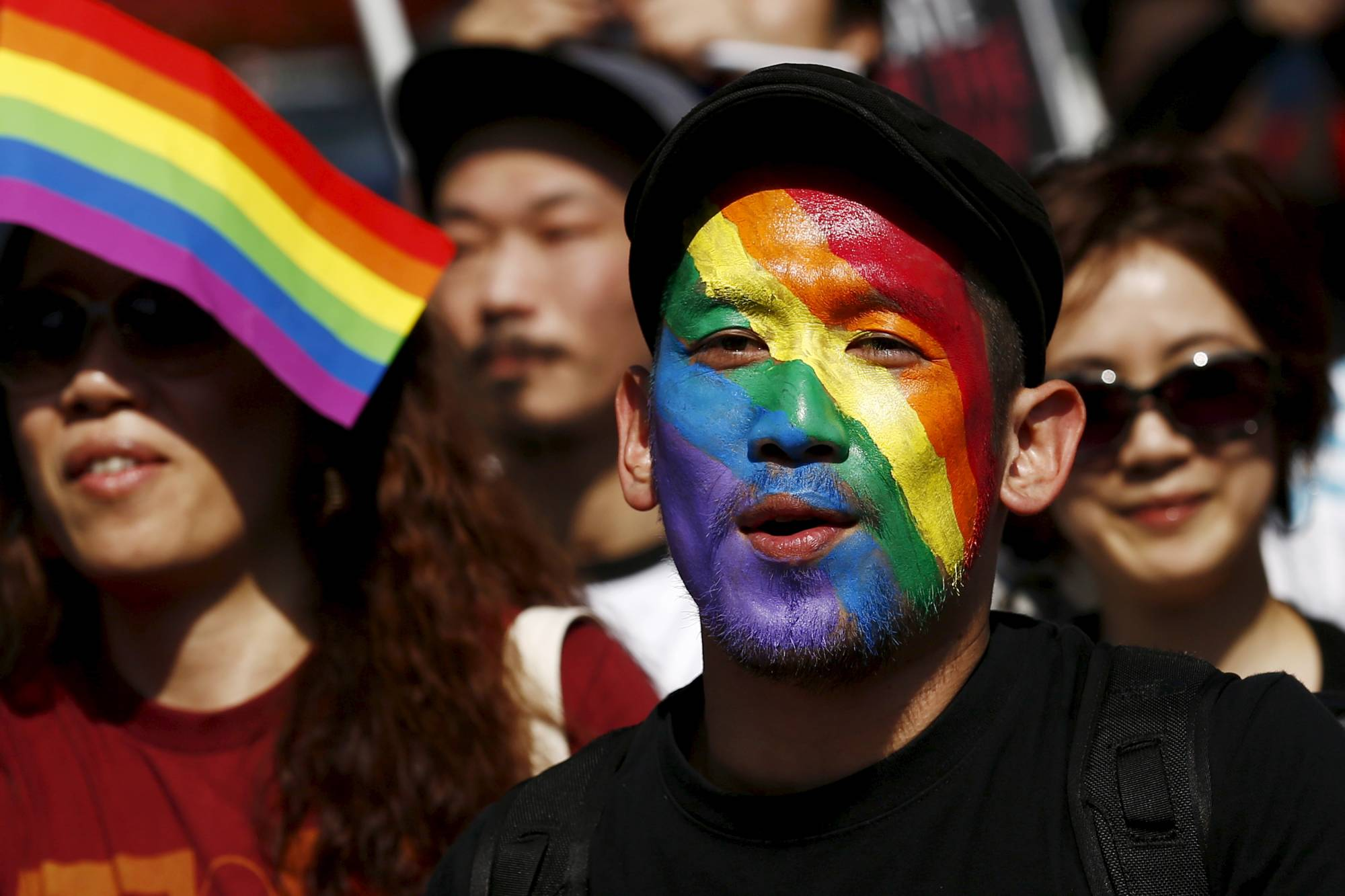 Members of the LGBTQ community and their supporters participate in the Tokyo Rainbow Pride parade in April 2015.     REUTERS