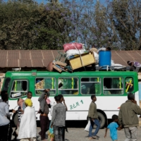 A bus carrying displaced people arrives at the Tsehaye primary school, which was turned into a temporary shelter, in the town of Shire on March 14. | REUTERS