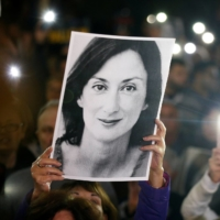 People gather at the Great Siege Square in Valletta, Malta, in November 2019 to call for the resignation of Joseph Muscat following the arrest of one of the country's most prominent businessmen as part of an investigation into the murder of journalist Daphne Caruana Galizia. | REUTERS