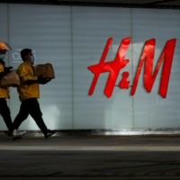 An H&M store in a shopping area in Beijing | REUTERS