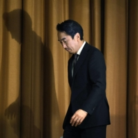 Line Corp. CEO Takeshi Idezawa leaves a news conference on March 23 in Tokyo. The messaging app operator said it has blocked access to private information from its Chinese affiliate. | KYODO
