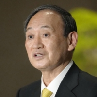 Prime Minister Yoshihide Suga speaks to reporters at the Prime Minister's Office on Wednesday evening.  | KYODO