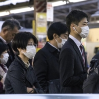 Commuters in Tokyo have returned to work in larger numbers since the second state of emergency was lifted. | BLOOMBERG