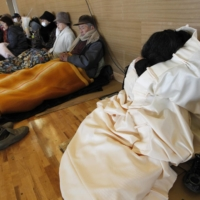 Yoshihiro Mizutani was inspired to make beds from heat-insulating cardboard after seeing television footage of older people suffering from hypothermia at shelters after the disasters of March 11, 2011. | REUTERS
