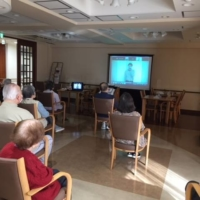 With many recreational activities canceled during the pandemic, nursing care provider Sompo Care Inc., hosts daily events streamed live on large television screens installed in its nursing facilities. | COURTESY OF SOMPO CARE INC.