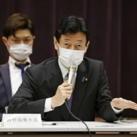 Yasutoshi Nishimura, minister in charge of COVID-19 policies, speaks at a government meeting on coronavirus measures in Tokyo on Thursday. | KYODO