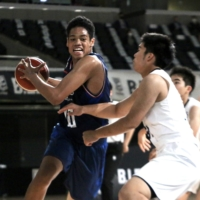 Earthfriends' Shawn Marion Williams competes during the third-place game of the 2020-21 B. League U-15 Championship at Tokyo Metropolitan Gymnasium on Tuesday.  | KAZ NAGATSUKA
