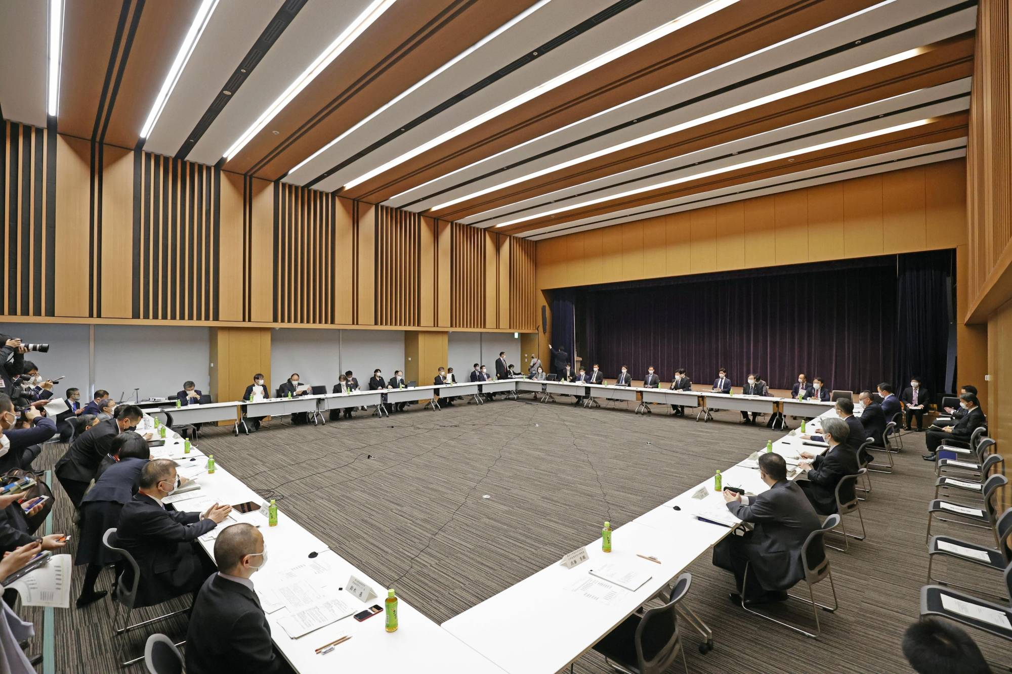 Government officials hold a meeting on COVID-19 policies in Tokyo on Thursday. | KYODO