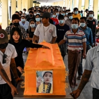 A funeral is held for a protester killed amid the crackdown by security forces on demonstrations against the military coup, in Yangon on March 30. | AFP-JIJI