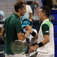 MAR 31, 2021; MIAMI, FLORIDA, USA; ROBERTO BAUTISTA AGUT  OF SPAIN (R) SHAKES HANDS WITH DANIIL MEDVEDEV OF RUSSIA (L) AFTER THEIR MATCH IN A MEN'S SINGLES QUARTERFINAL IN THE MIAMI OPEN AT HARD ROCK STADIUM. MANDATORY CREDIT: GEOFF BURKE-USA TODAY SPORTS