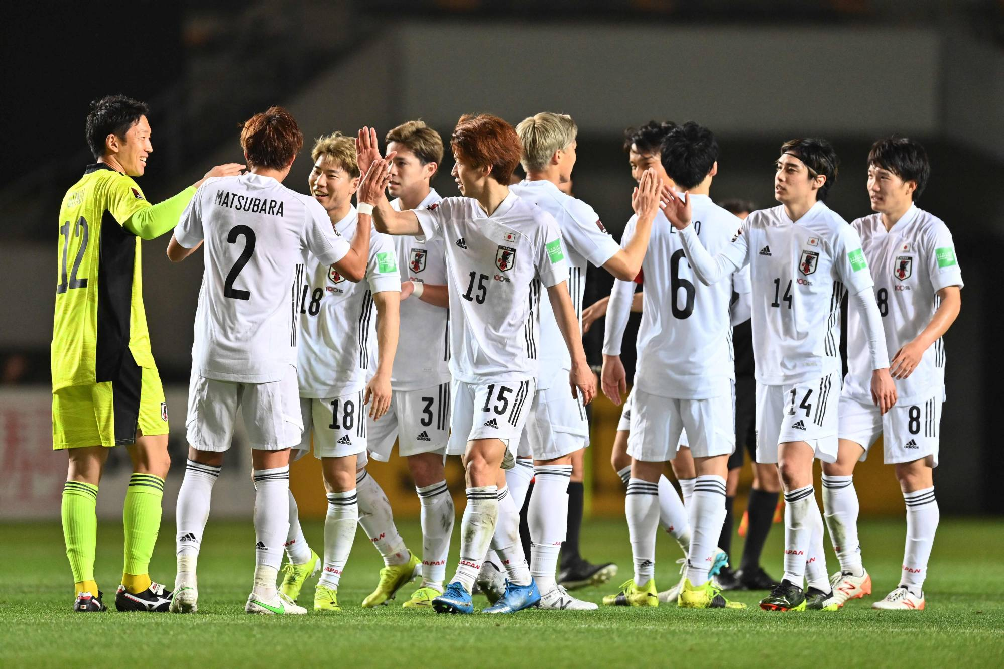 Samurai Blue players celebrate after their 14-0 win over Mongolia on Tuesday. | AFP-JIJI