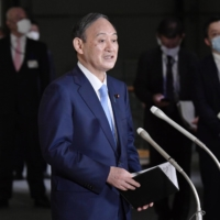 Prime Minister Yoshihide Suga speaks to reporters Thursday at the Prime Minister's Office. | KYODO