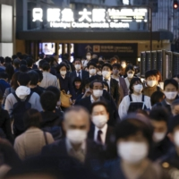 People in Osaka's Umeda district Thursday | KYODO