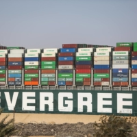 The Ever Given container ship, which was chartered by Taiwan's Evergreen Marine Corp., moves along the Suez Canal after being freed on March 29. | BLOOMBERG