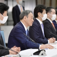 Prime Minister Yoshihide Suga announces new COVID-19 countermeasures for Osaka, Hyogo and Miyagi prefectures during a task force meeting at the Prime Minister's Office on Thursday.  | KYODO