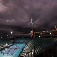 The court at Grandstand Stadium is dried during a rain delay during the Miami Open on April 1. | USA TODAY / VIA REUTERS