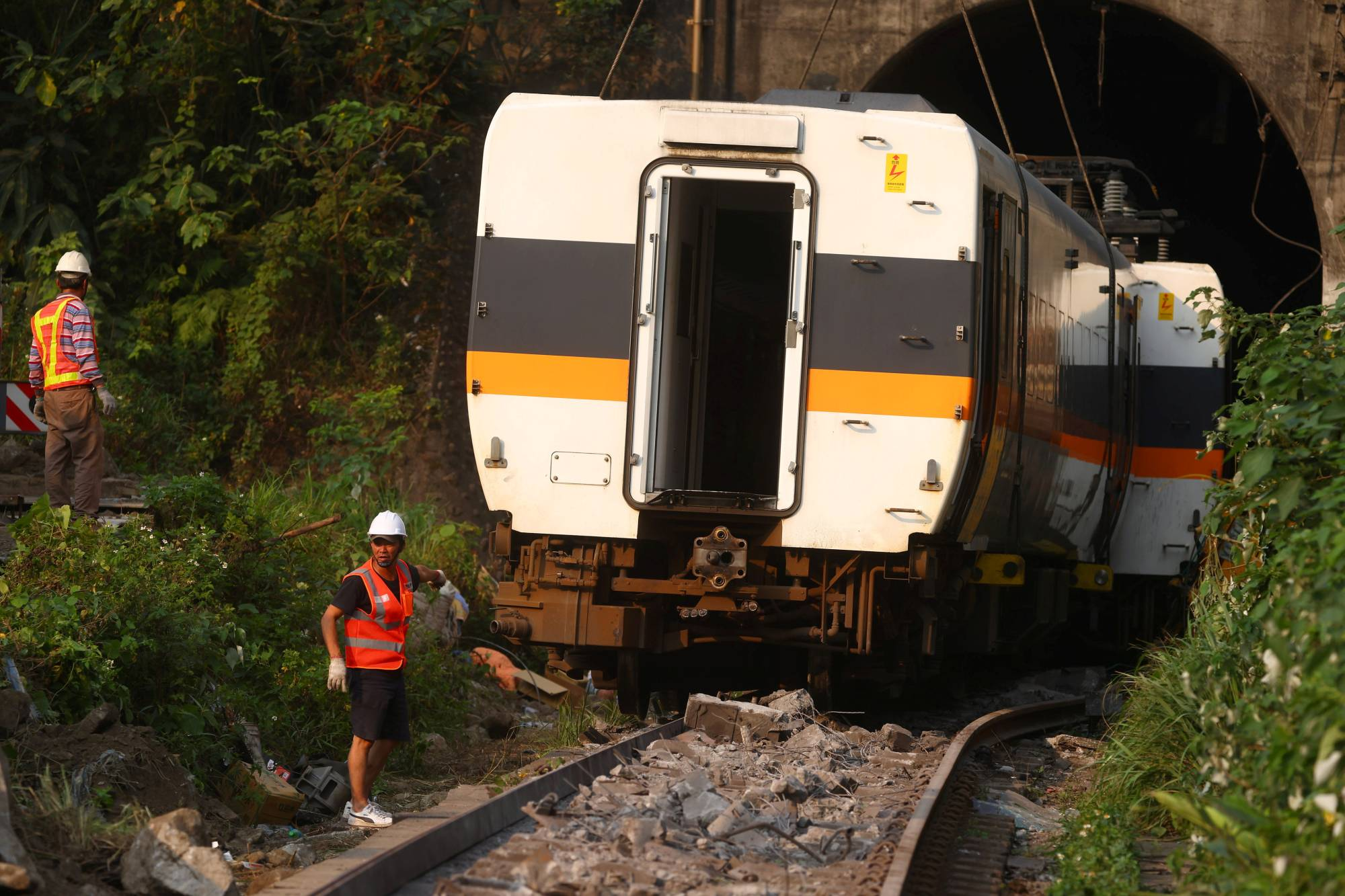 Rescuers work at the site of a deadly train derailment at a tunnel north of Hualien, Taiwan, on Saturday. | REUTERS