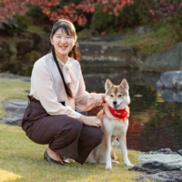 Princess Aiko, daughter of Emperor Naruhito and Empress Masako, poses for a photograph with her pet dog Yuri at the Akasaka Estate residence in Tokyo, in November.  | IMPERIAL HOUSEHOLD AGENCY / VIA REUTERS