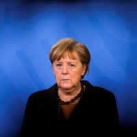 German Chancellor Angela Merkel briefs the media after a virtual meeting with federal state governors at the chancellery in Berlin on March 30.  | POOL / VIA REUTERS