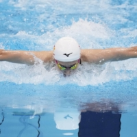 Rikako Ikee swims during the women's 100-meter butterfly semifinals on Saturday at the national championships. | KYODO
