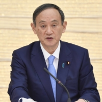 Prime Minister Yoshihide Suga speaks about new virus measures for Osaka, Hyogo and Miyagi prefectures on Thursday at the Prime Minister's Office.  | KYODO