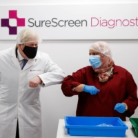 British Prime Minister Boris Johnson visits a diagnostics firm in February. Future historians may point to our encounter with COVID-19 to explain the inexplicable demise of handshakes and the rise of elbow-bumping.   | REUTERS