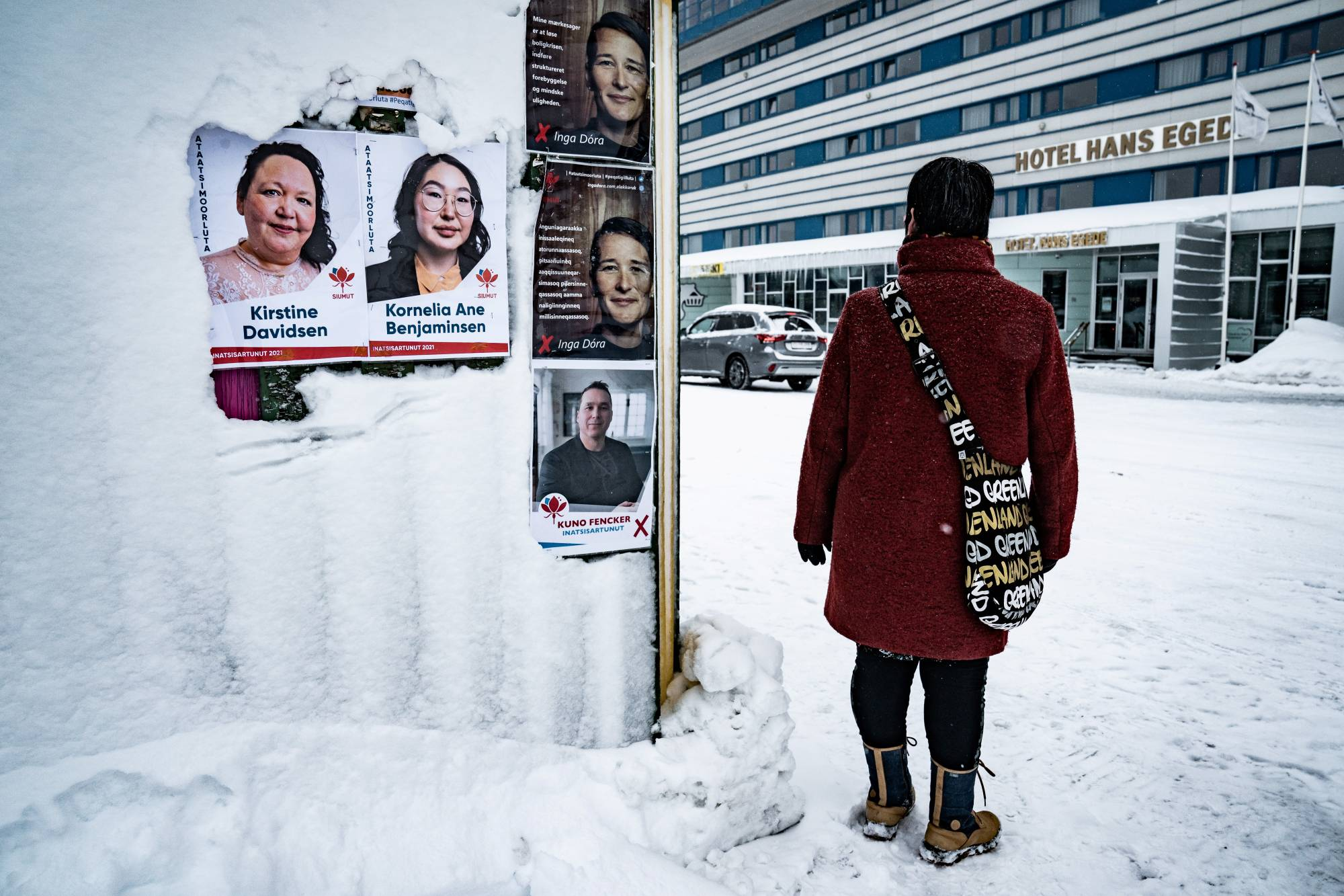 Electoral posters are displayed ahead of the April 6 parliamentary election, in Nuuk, Greenland.  | RITZAU SCANPIX / VIA REUTERS
