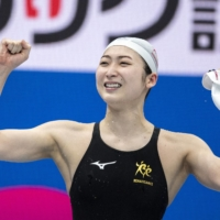 Rikako Ikee reacts after winning the 100-meter butterfly final during the national championships on Sunday. | AFP-JIJI