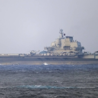 China's Liaoning aircraft carrier sails through the Miyako Strait near Okinawa over the weekend. | JAPAN DEFENSE MINISTRY / VIA KYODO