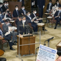 Prime Minister Yoshihide Suga speaks at an Upper House Audit Committee meeting on Monday. | KYODO