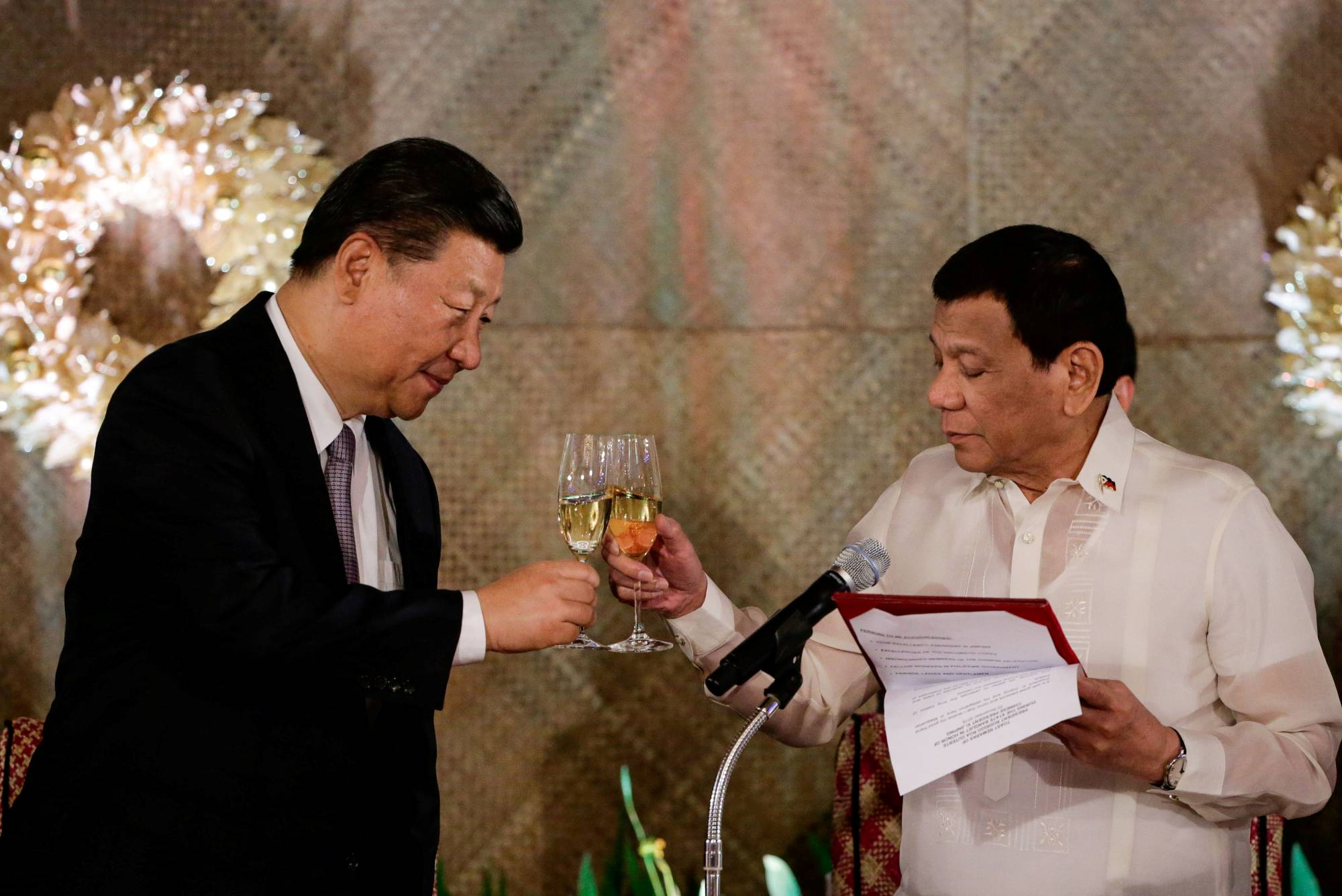China's President Xi Jinping and Philippine President Rodrigo Duterte toast during a state banquet at the Malacanang presidential palace in Manila on Nov. 20, 2018. | POOL / VIA REUTERS